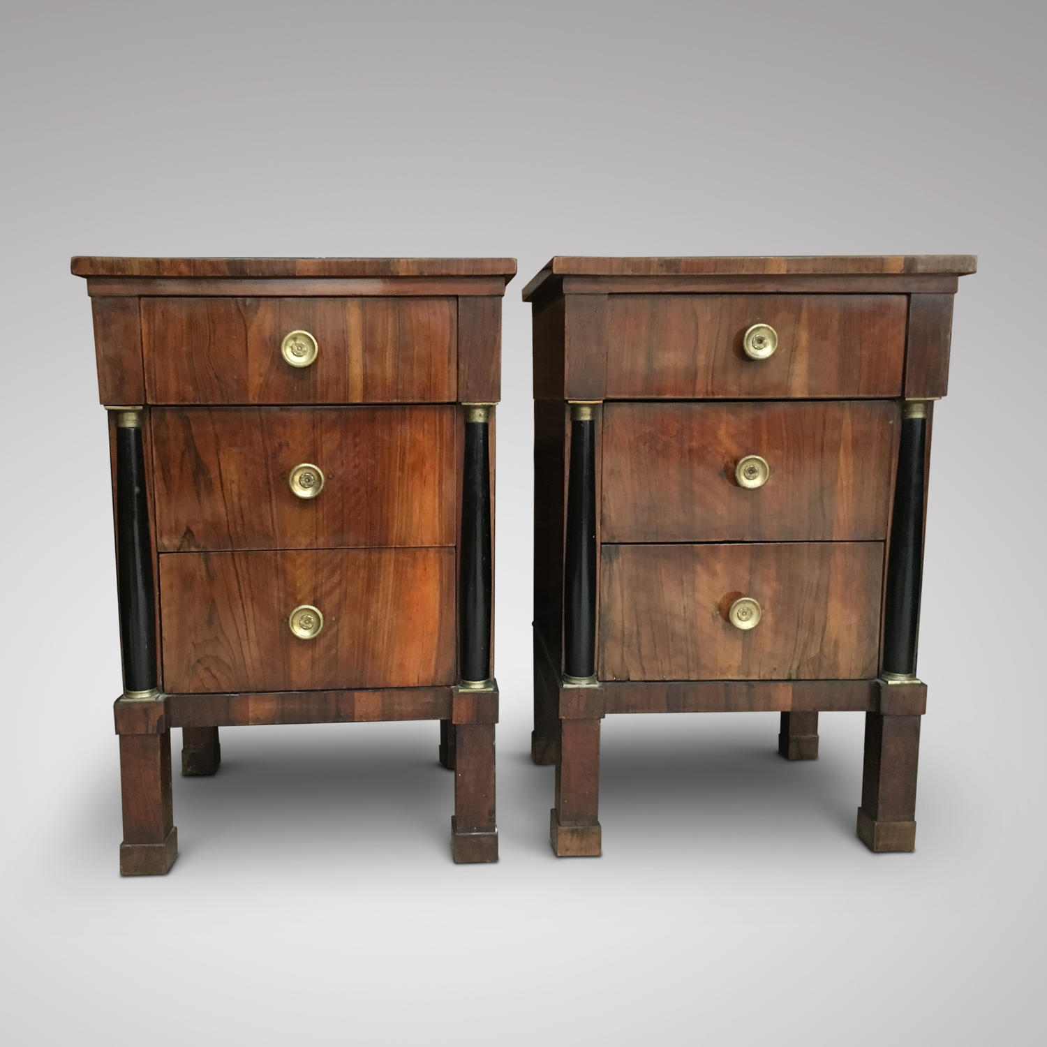 A PAIR OF EARLY 19TH CENTURY WALNUT COMMODINI