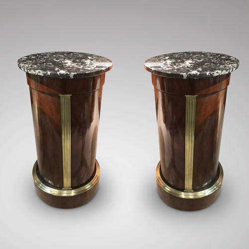 A PAIR OF BALTIC BRASS MOUNTED MAHOGANY COLUMNS