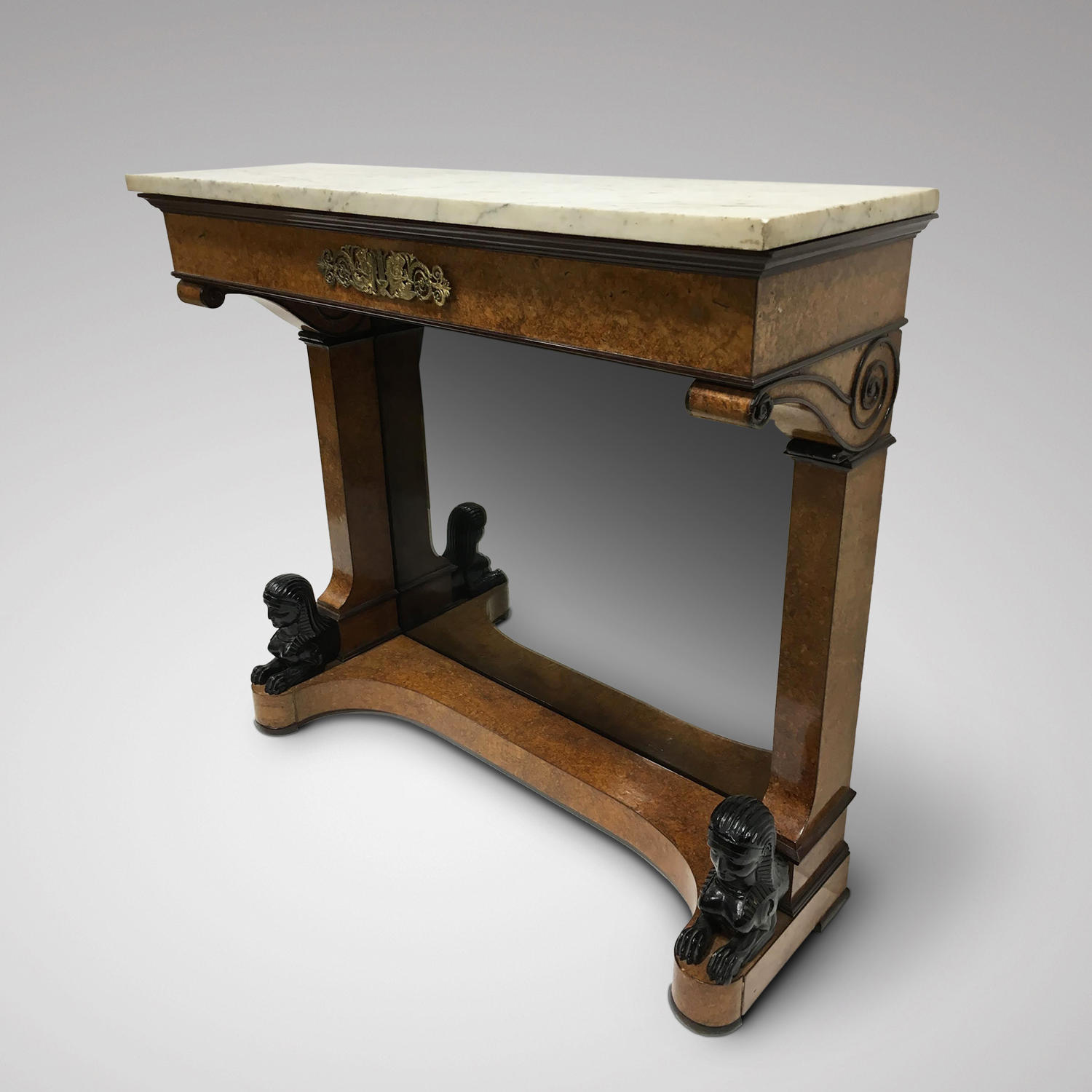 A SMALL AMBOYNA VENEERED EMPIRE CONSOLE