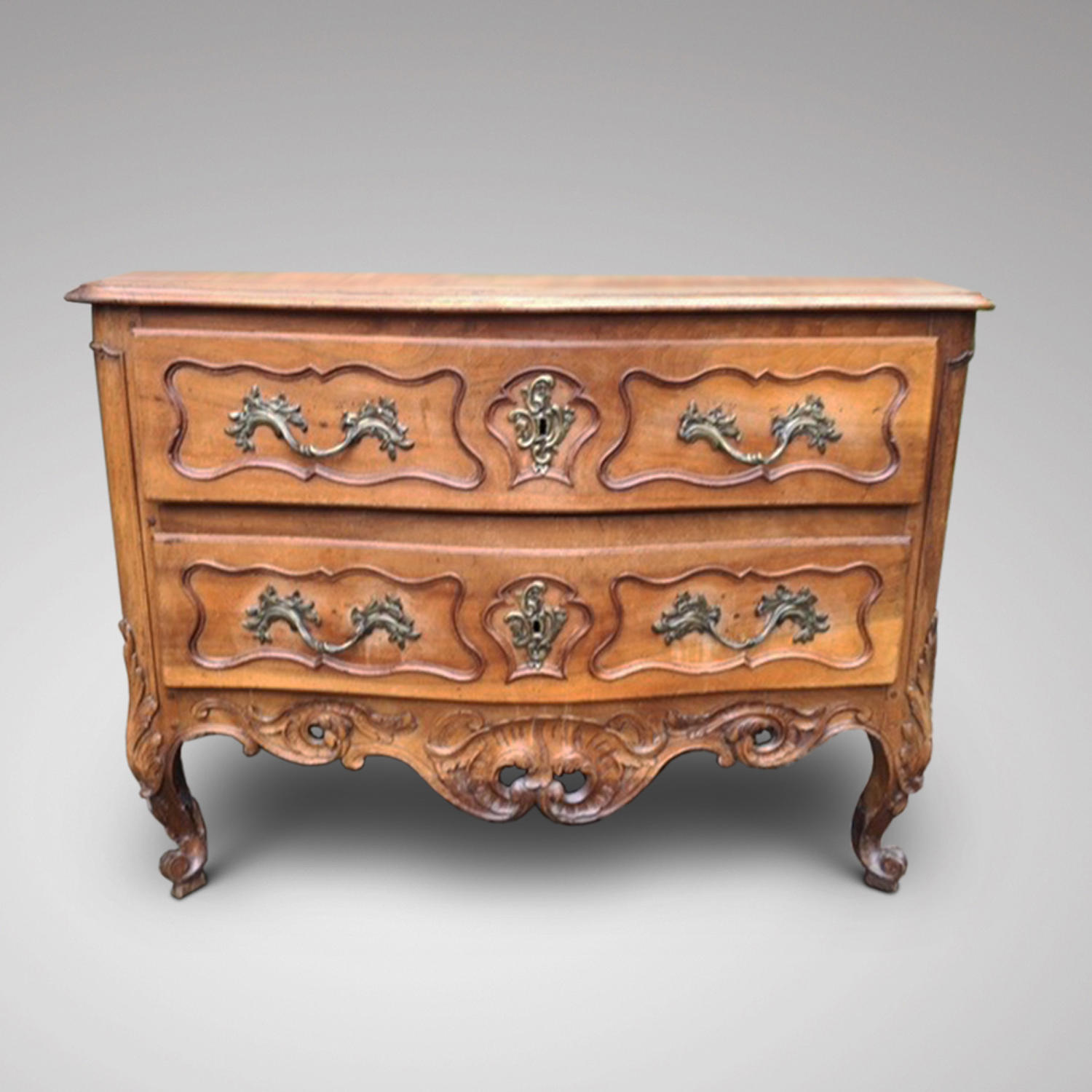 AN 18TH CENTURY  FRENCH PROVINCIAL FRUITWOOD COMMODE