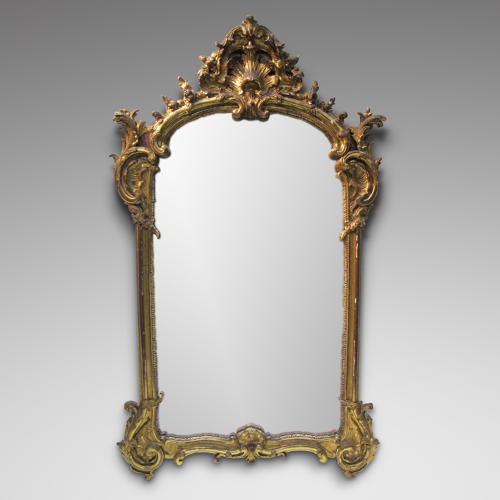A LOUIS XV PERIOD CARVED GILTWOOD MIRROR