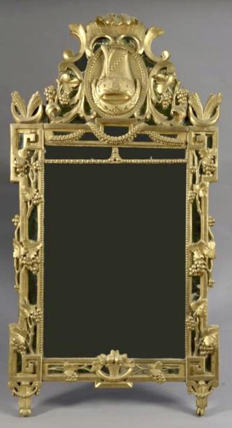 A LOUIS XVI PERIOD GILT MIRROR