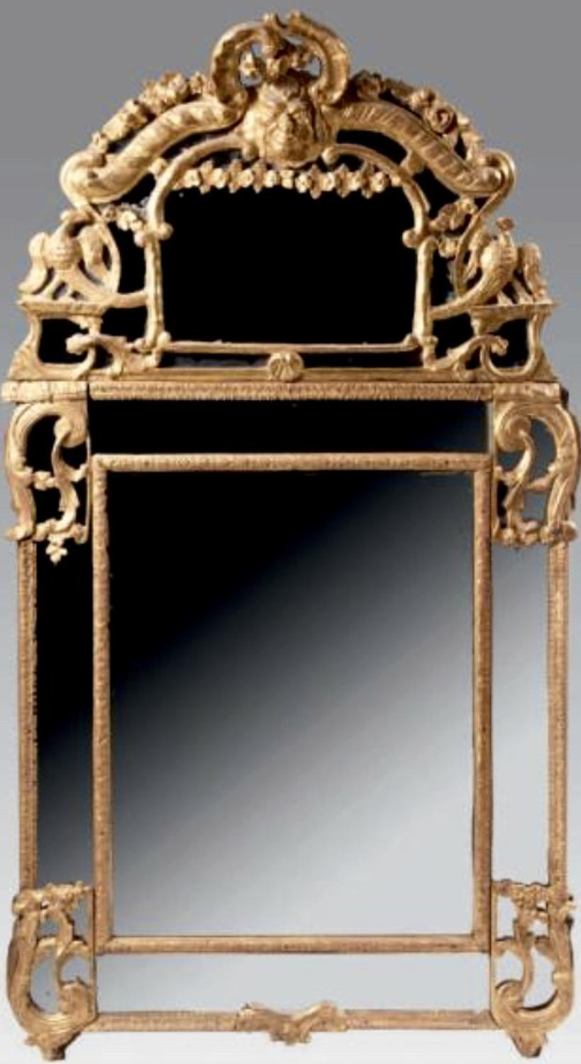 AN EARLY LOUIS XV PERIOD GILT MIRROR