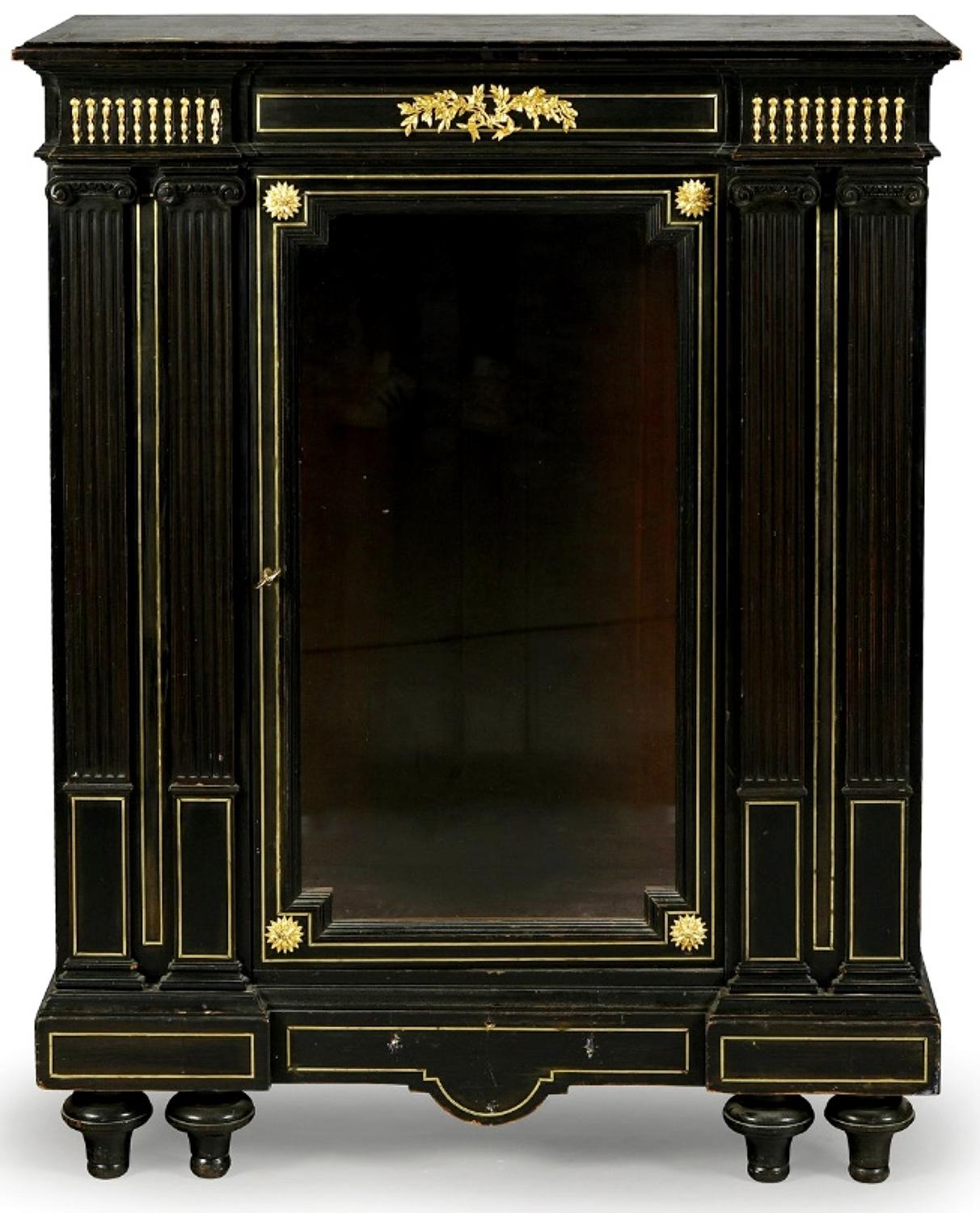 A BRASS MOUNTED EBONY GLAZED CABINET