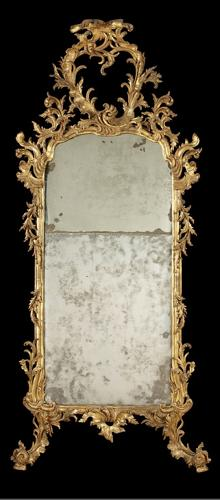 A NORTH ITALIAN LATE  C. 18TH CARVED GILTWOOD MIRROR