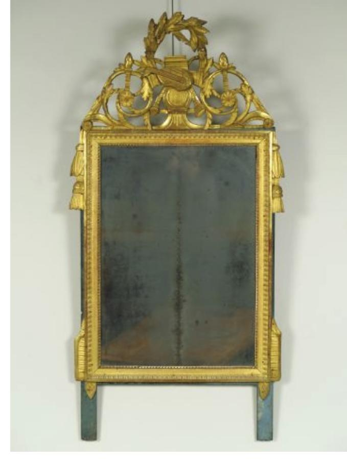 A CARVED GILTWOOD LOUIS XVI PERIOD MIRROR