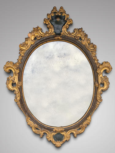 A RARE EARLY 18TH CENTURY VENETIAN OVAL MIRROR