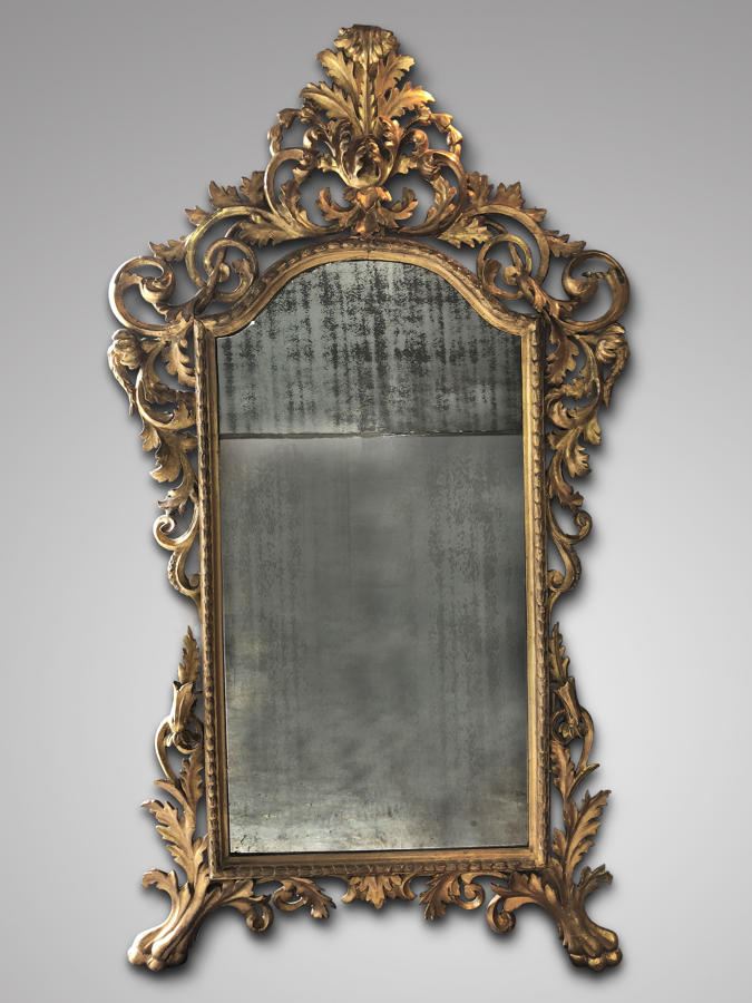 AN 18TH CENTURY ITALIAN BAROQUE MIRROR