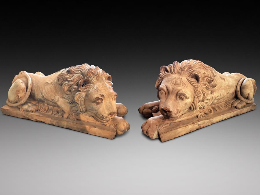 A pair of early 19th century terra-cotta lions