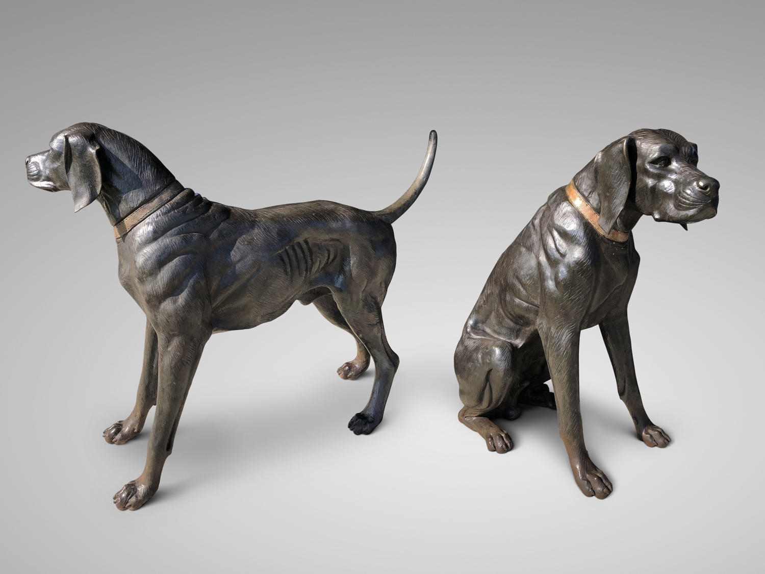 A PAIR OF LIFE-SIZE BRONZE HOUNDS