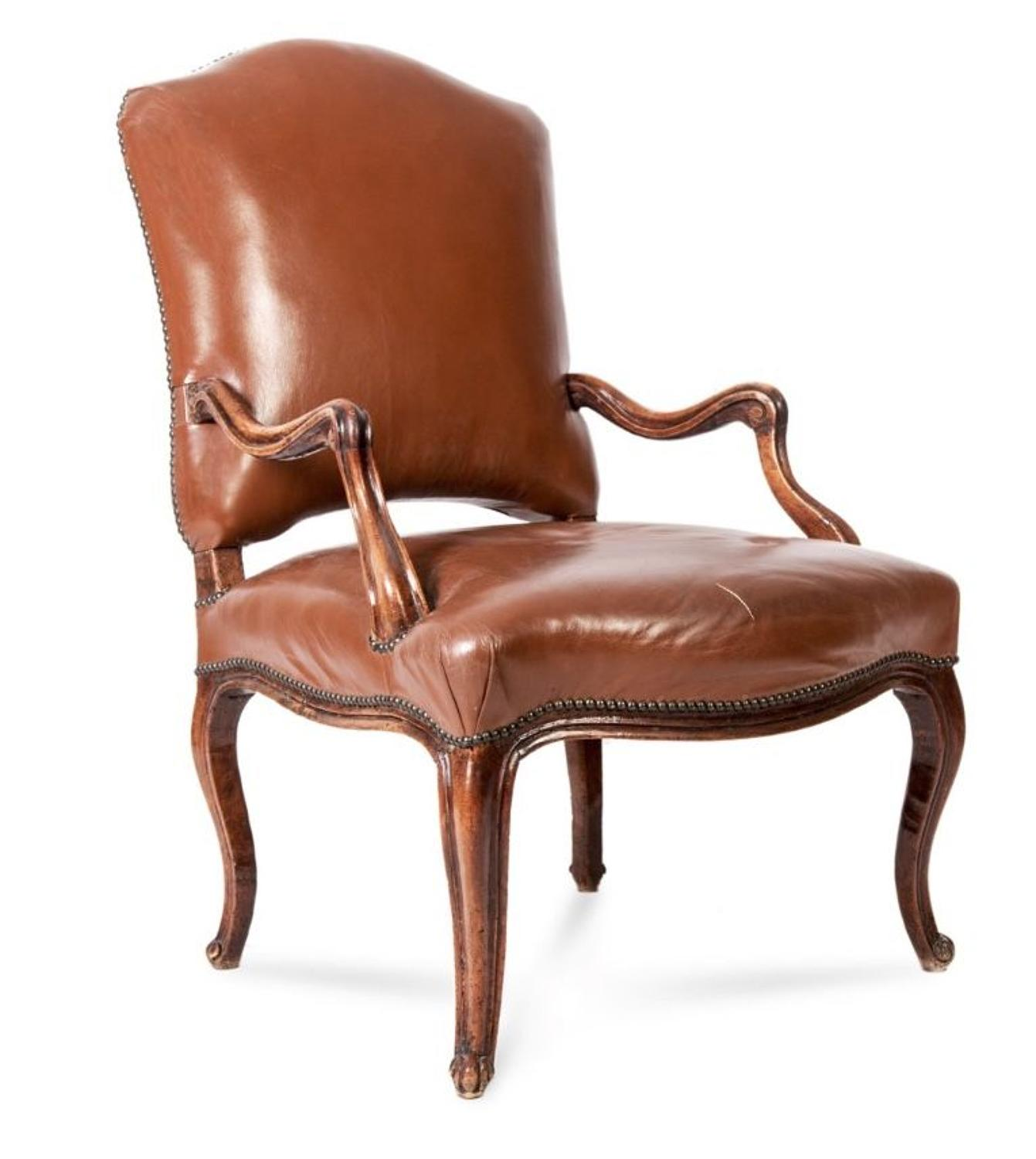 A REGENCE  PERIOD WALNUT ARMCHAIR