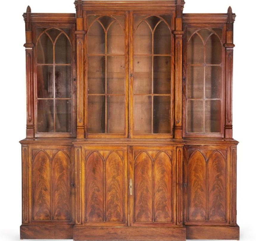 AN ENGLISH MAHOGANY BREAKFRONT BOOKCASE