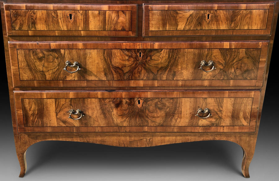 AN EARLY 19TH CENTURY FIGURED WALNUT COMMODE. ITALY/