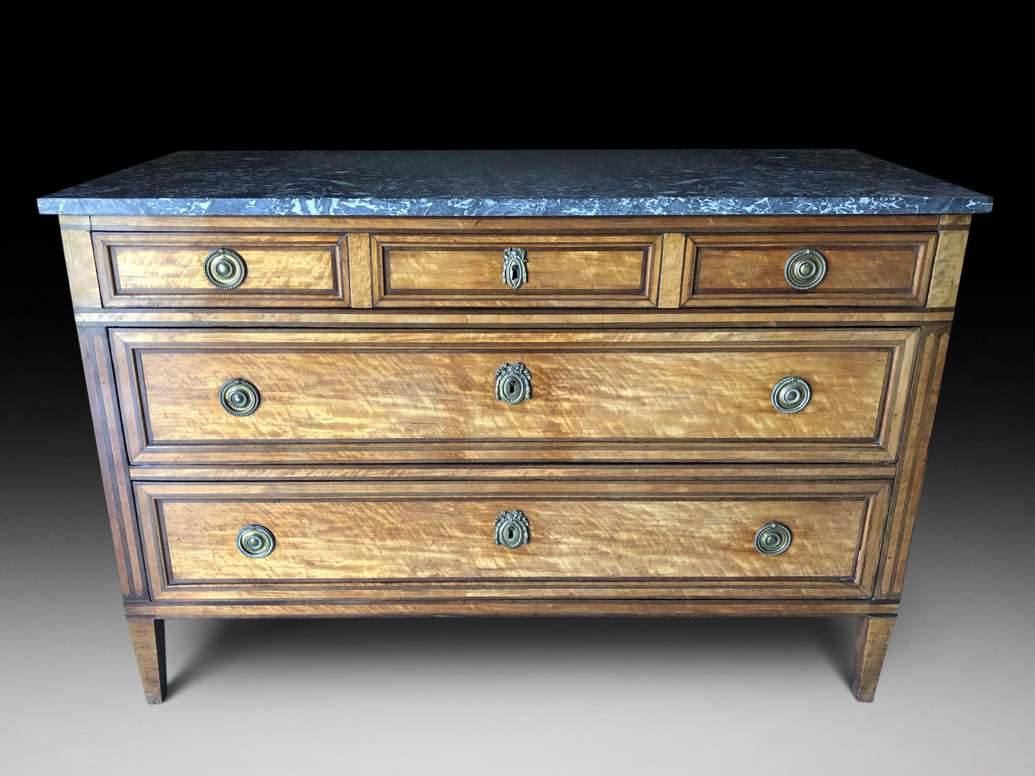 A LOUIS XVI PERIOD SATINWOOD COMMODE