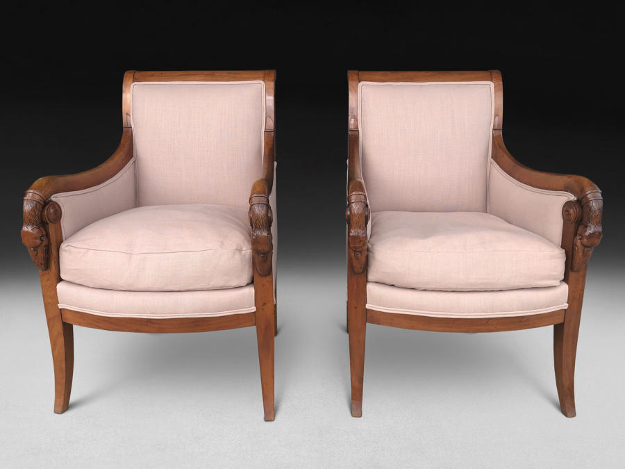 A PAIR OF EARLY 19TH CENTURY BERGERE ARMCHAIRS