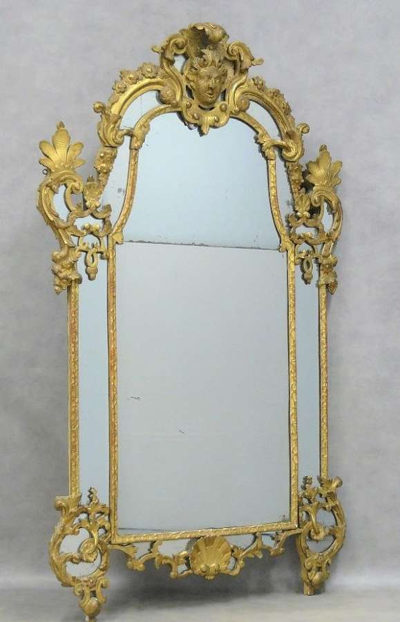 AN IMPORTANT REGENCE PERIOD CARVED GILTWOOD MIRROR